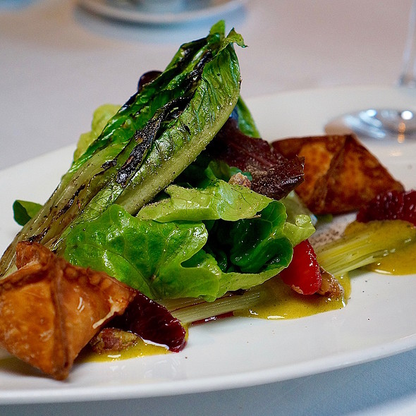 Grilled baby romaine lettuce, seasonal salad greens. blood orange vinaigrette, peekytoe crab wontons, pistachio sabayon