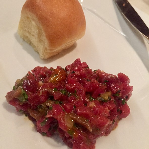 The Classic Tartare With Beef Sirloin, Savora Mustard, Egg Yolk, Anchovy, And Parker House Roll