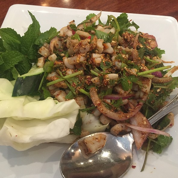 Spicy Squid Salad With Onions, Lettuce, And Lime Juice