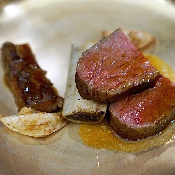 Beef rib steak, braised in pear, cucumber water, braised fern