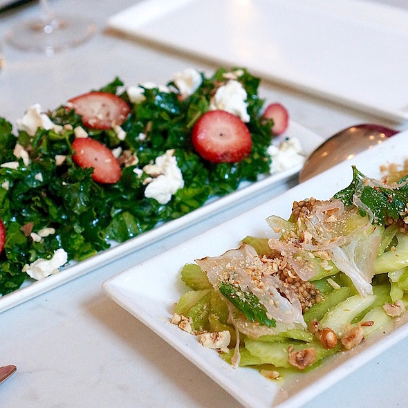 Celery salad, hazelnuts speck, Thai chilis, pickled mustard seeds; Kale salad, strawberries, goat cheese, almond, horseradish vinaigrette
