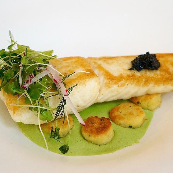 Pan seared halibut, American caviar, Parisian gnocchi, arugula crème