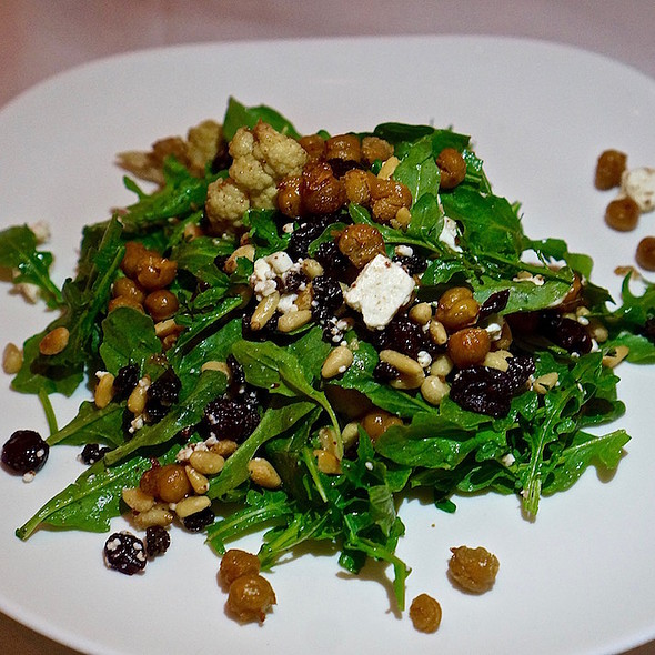 Mediterranean arugula salad, roasted cauliflower, crispy garbanzo beans, dried currants, craisins, toasted pine nuts, feta, tangy sumac berry vinaigrette