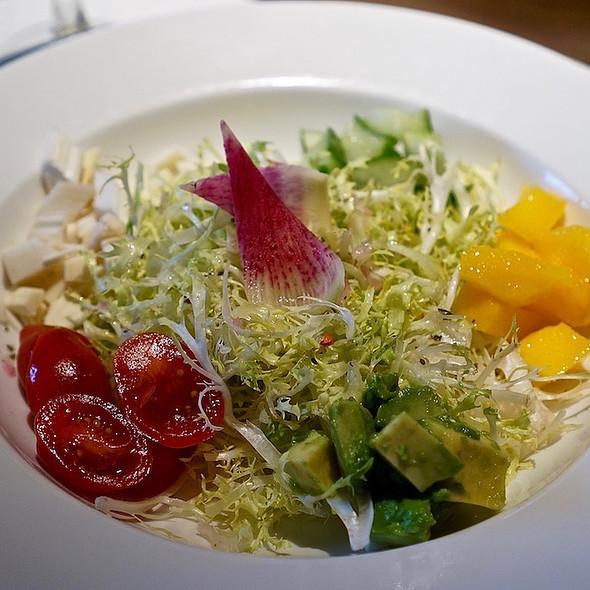 Frisée salad, lime shallot thyme vinaigrette, mango, cherry tomatoes, fresh palm hearts, cucumber, watermelon radish, avocado