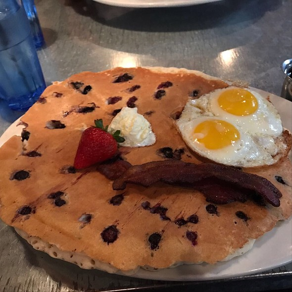 Huge Blueberry Pancake With Sunny-Side-Up Eggs And Bacon