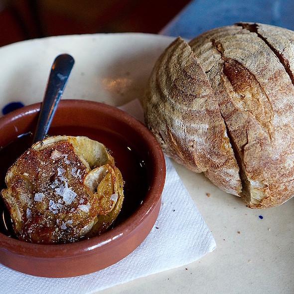 Local grain sourdough bread, roasted garlic, olive oil