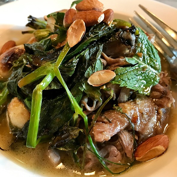 Braised Lamb With Pea Shoots, Mint, And Roasted Almonds