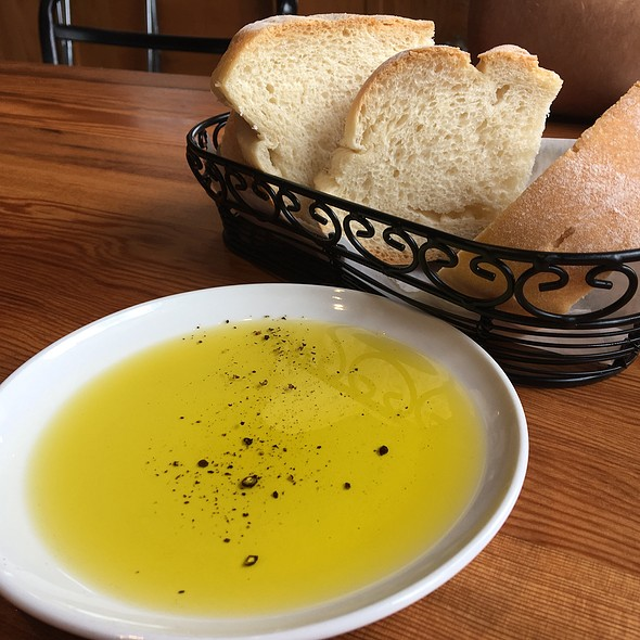 Fresh Bread And Olive Oil With Cracked Pepper