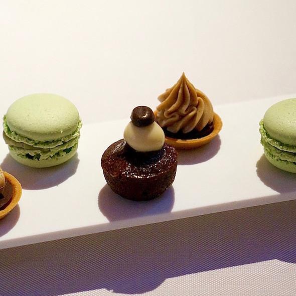 Mignardise – pistachio macarons, chocolate coffee cake, cherry chestnut tarts