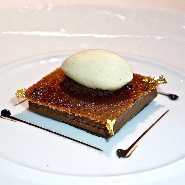 Contemporary dark chocolate tart, bourbon vanilla ice cream