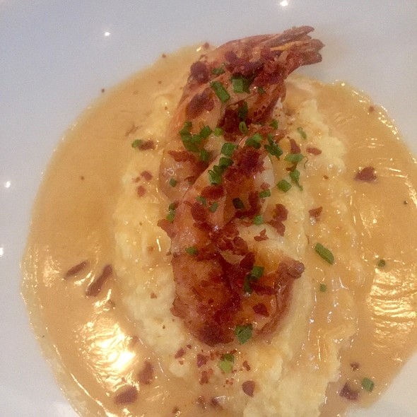 Shrimp & Grits With Country Ham, Manchego Cheese, And Espelette Pepper