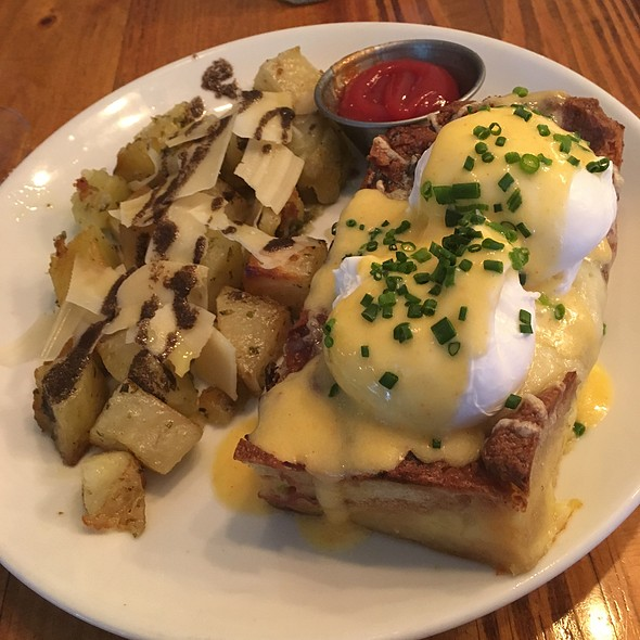 Eggs Benedict on savory bread pudding