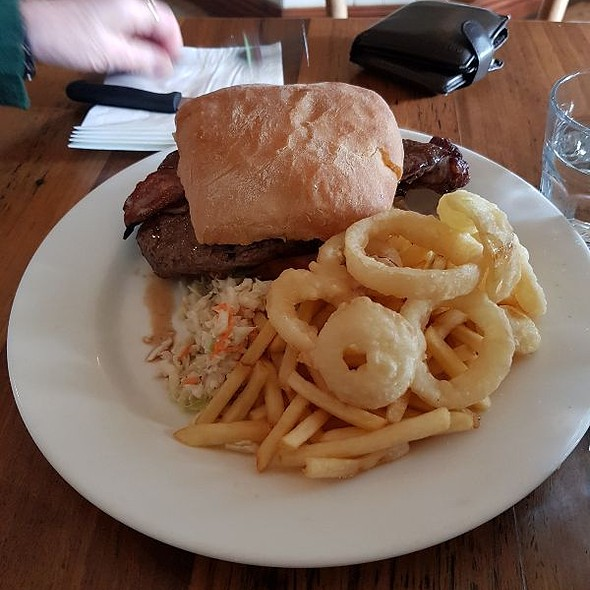 Steak Sandwich With Chips Onion Rings And Coleslaw