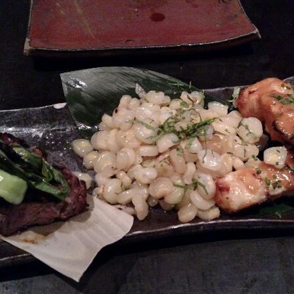 Wagyu Beef and Chilean Miso Sea Bass with Peruvian Corn