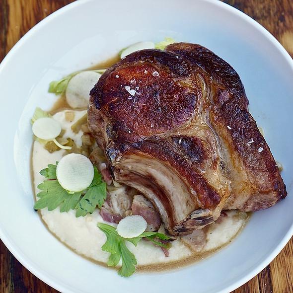 Double cut Berkshire pork chop, miso mash, apple bacon hash, ham hock jus