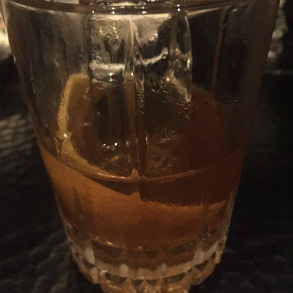 Old Fashioned Cocktail With Bourbon, Strawberry, Multiple Fernets, And Orange Oil