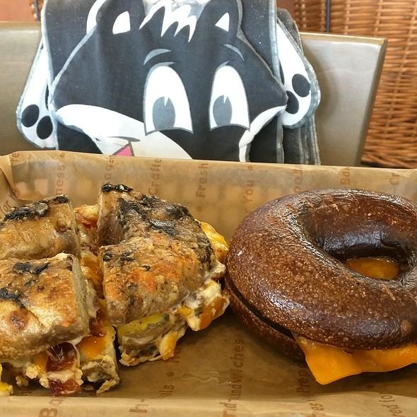 Hot Parm & Bacon sandwich and Espresso Buzz Bagel & Bacon sandwich @ Einstein Bros Bagels