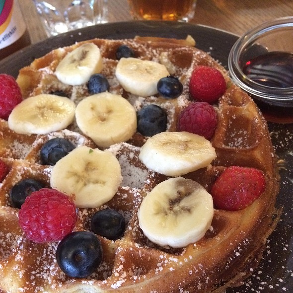 Waffle with fresh fruits and maple syrup