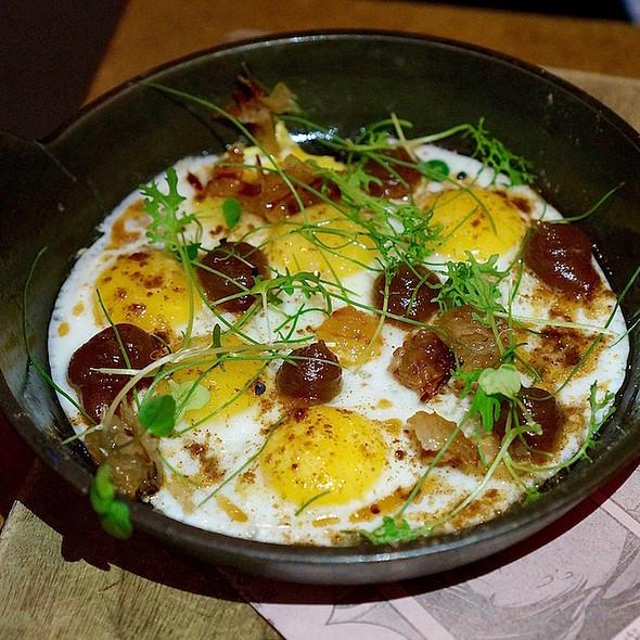 Cast iron quail eggs, smoky date purée, pancetta, maple-sherry reduction