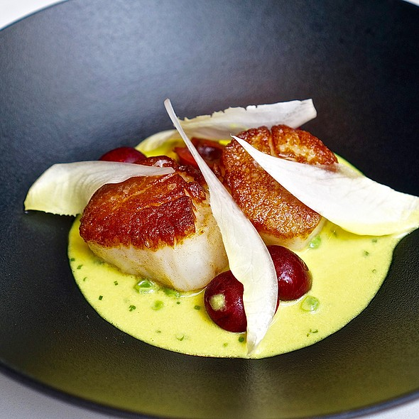 Diver scallops, yellow curry, peas, carrots, cherries