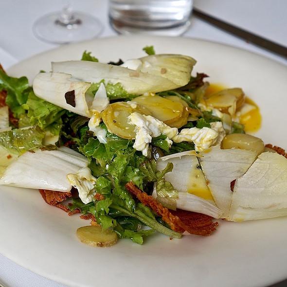 Endive salad, crispy potato, basil, Dijon, poached egg