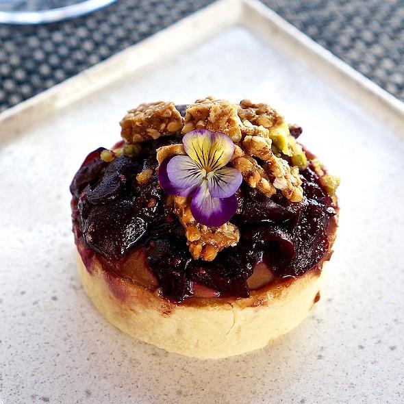 Lapins cherry tart, Manjari chocolate, pistachios, buckwheat