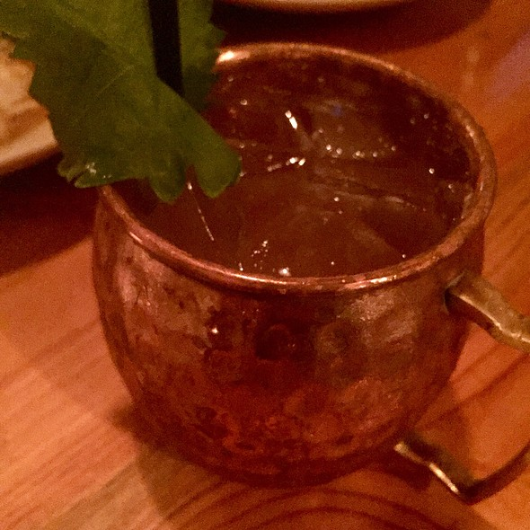 Silver Dollar Cocktail With Cucumber Infused Vodka, Ancho Reyes, Lime, Ginger Beer, And Shiso Leaf