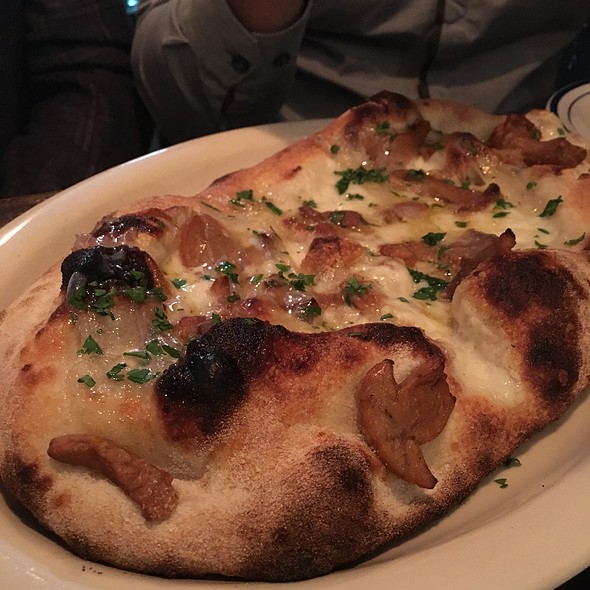 Pinsa Corviale: Buffalo Mozzarella, Porcini Mushrooms, Lardo And Parsely