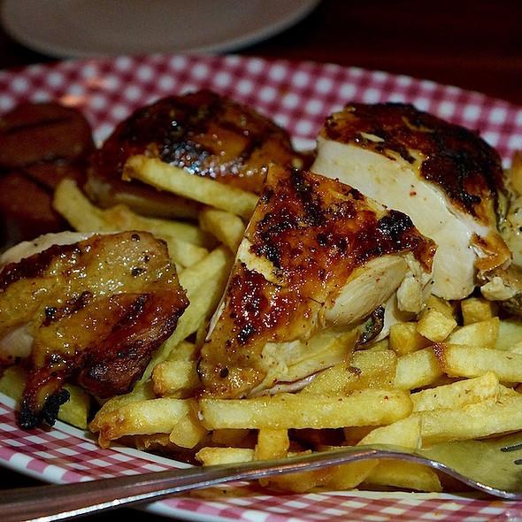 Half roast chicken, sausage, frites