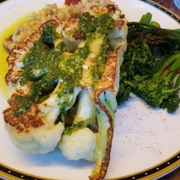Cauliflower steak, romesco sauce, broccolini, and risotto