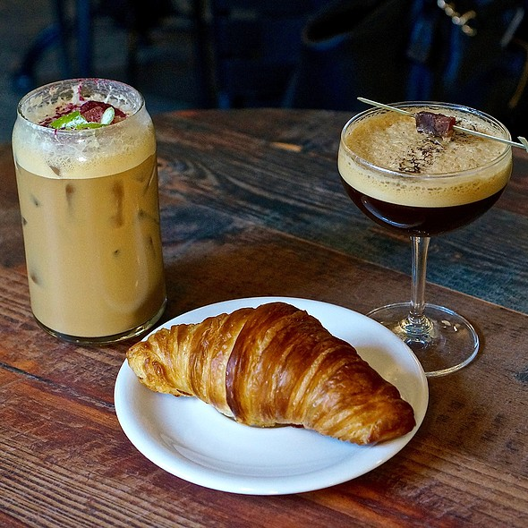 Iced spiced latte, cold smoked espresso and croissant @ Coat Check Coffee