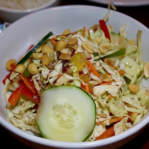 Crunchy cabbage salad, red onions, carrots, red and green bell pepper, cucumber, roasted peanuts