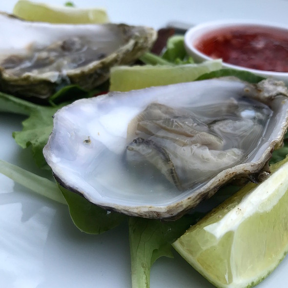 Oyster with lemon and vinaigrette