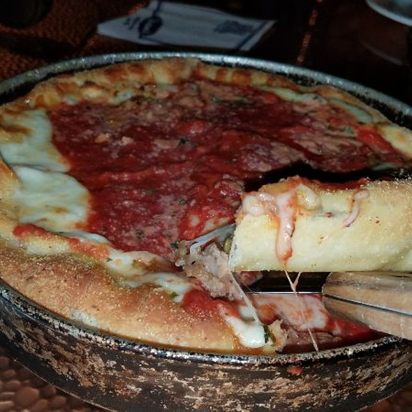 Deep Deep Dish Pizza With Pepperoni, Sausage And Onions
