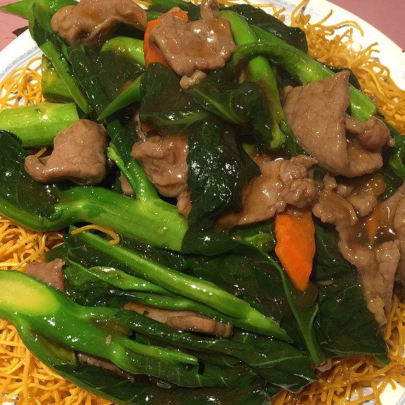 Chinese Broccoli And Beef Over Pan-Fried Noodles