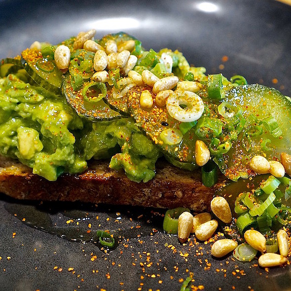 Avocado toast, sprouted rye, togarashi, cucumbers, pine nuts