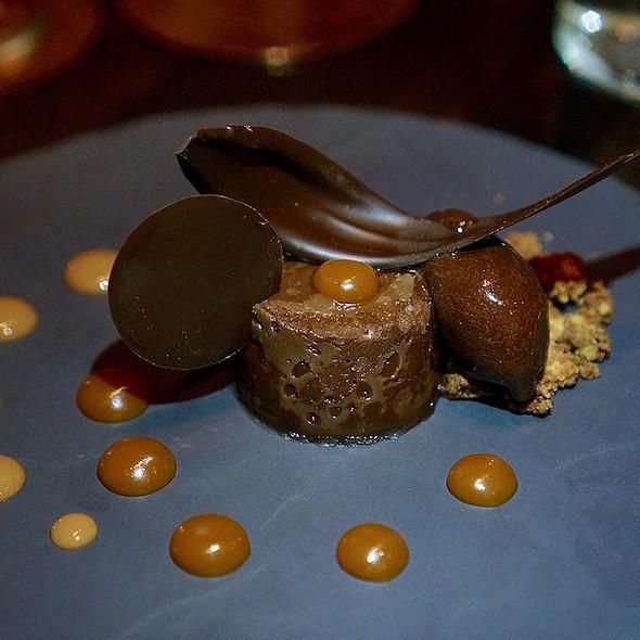 Espresso flourless Valrhona chocolate cake, almond crumble, spicy chocolate sorbet, whiskey caramel, Manjari fluid gel