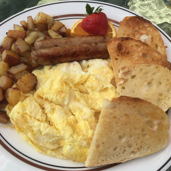 Scrambled Eggs With Cheddar Cheese, Home Fries, Sausage Links, And Sourdough Toast