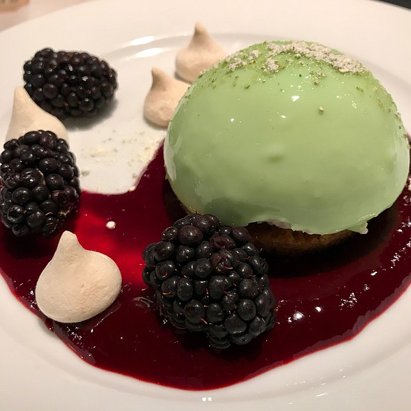 Key Lime Cheese Cake With Meringue Drops In Blackberry Sauce