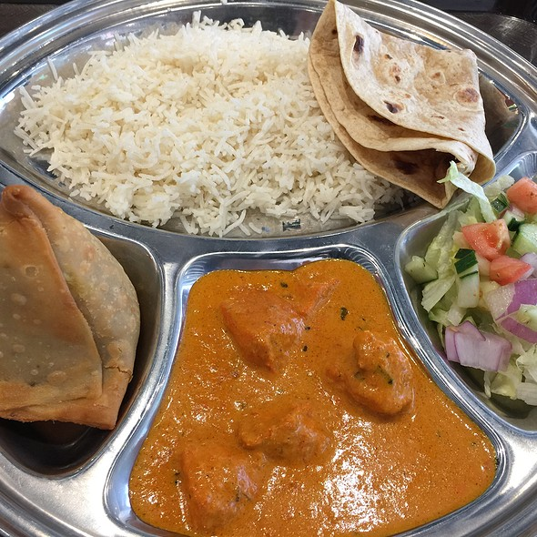 Chicken Tikka Masala Plate And A Samosa