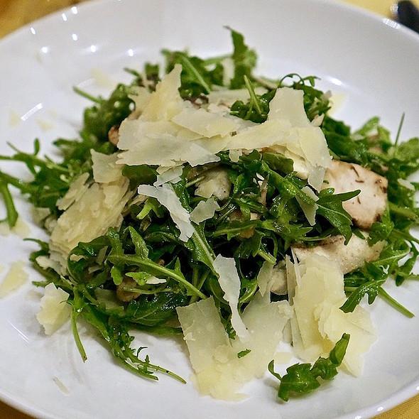 Arugula salad, shaved artichokes, portobellini mushrooms, parmesan, lemon truffle vinaigrette