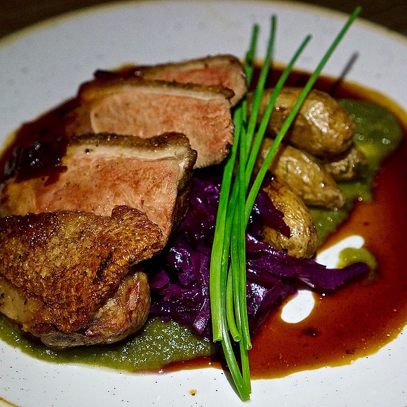 Liberty Farms duck breast, braised cabbage, spinach and sweet onion soubise, marble potatoes, cipollini sherry jus