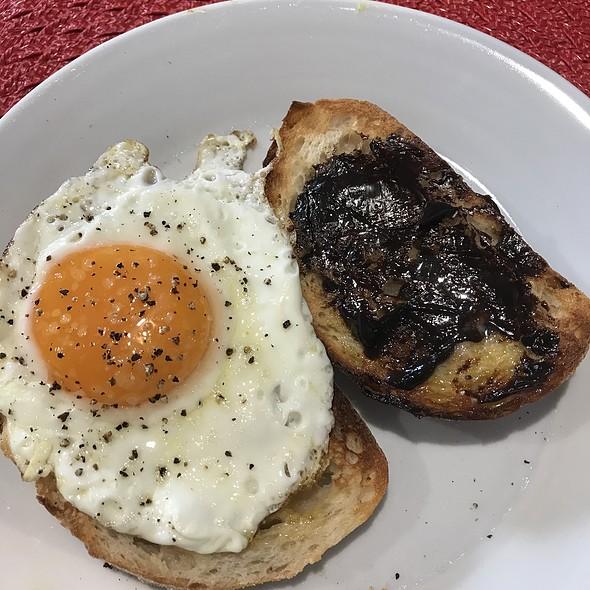 Sourdough toast, fried egg and vegemite @ Chookys