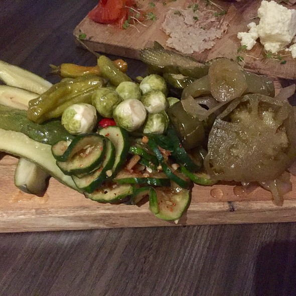 Pickle Plate with Pickled Green Tomatoes, Brussels Sprouts, Shishito Peppers, Onions, and Cucumbers
