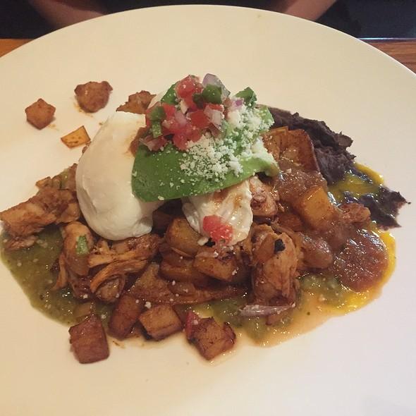 Huevos Rancheros with Over-Easy Eggs, Adobo Chicken, Black Bean Purée, Crispy Potato, and Ranchero Salsa