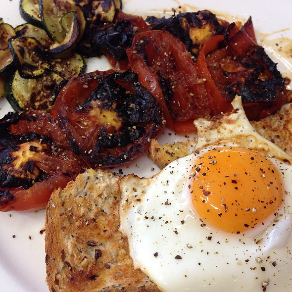 Fried Egg On Soy And Linseed Bread With Tomatoes And Zucchini