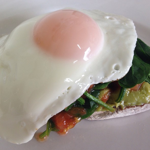 Egg On Oat And Rye Toast With Avocado And Tomato And Spinach