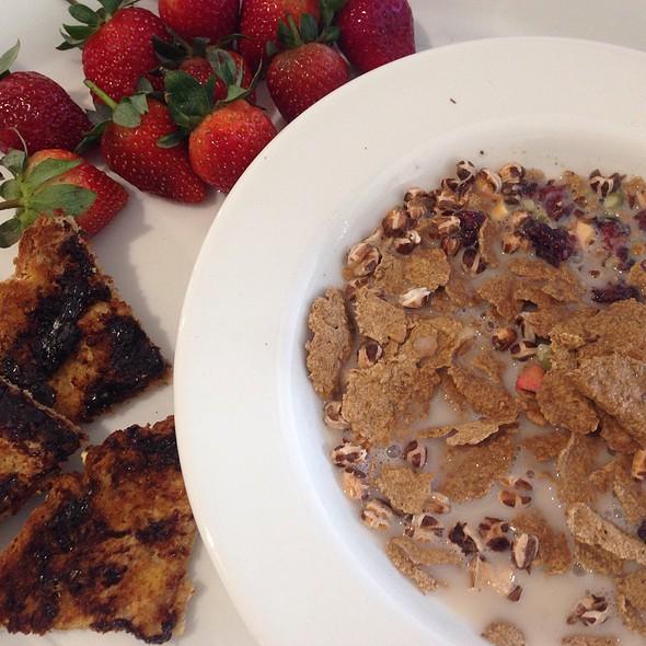 Apple, Cranberry & Bran Flakes With Macadamia Milk, Vegemite On Toast And Fresh Strawberries