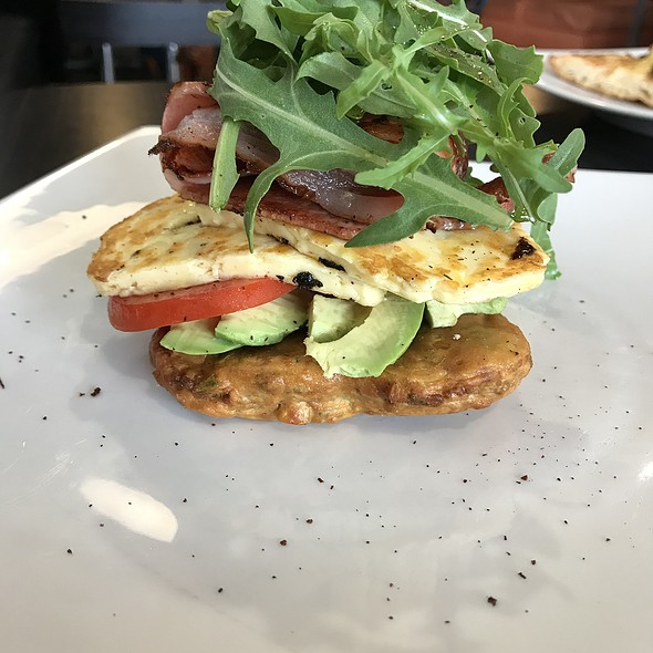Corn fritters with haloumi, avo, tomato and bacon