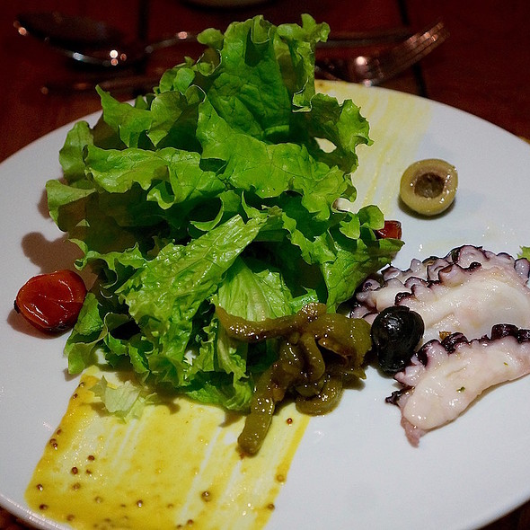 Green leaves salad, mustard octopus, roasted tomatoes, peppers, olives
